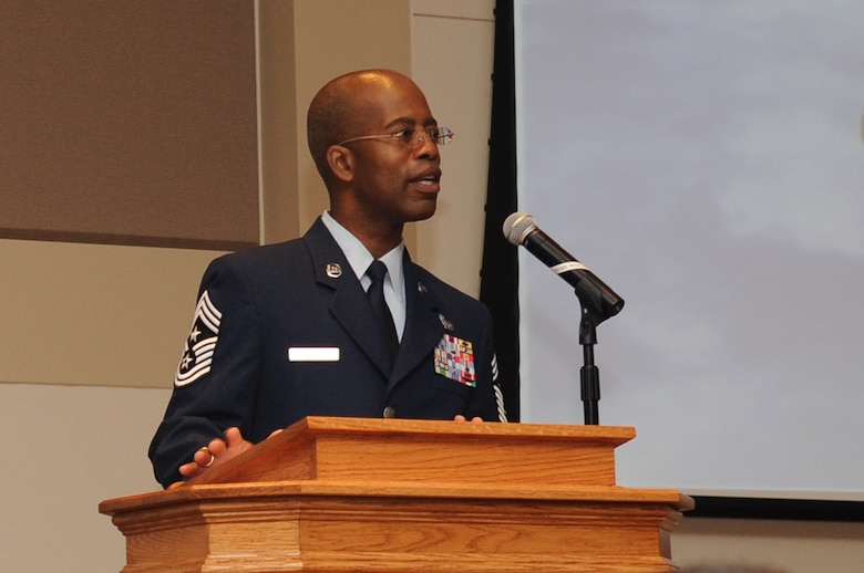 BUCKLEY AIR FORCE BASE, Colo. -- Chief Master Sgt. Robert Ellis, 460th Space Wing command chief, speaks to graduates at the Community College of the Air Force graduation May 27. (U.S. Air Force Photo by Airman 1st Class Manisha Vasquez)