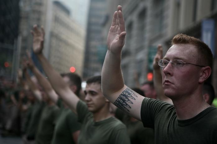 NEW YORK - Marines with Special Purpose Marine Air Ground Task Force New York raise their hands at the World Trade Center site after their commanding officer asked who among them enlisted after the Sept. 11 terrorist attacks. The Marines joined Sailors, Coast Guardsmen, New York police and firefighters in a memorial run to Ground Zero as part of Fleet Week New York 2010. (Official Marine Corps photo by Lance Cpl. Jad Sleiman)