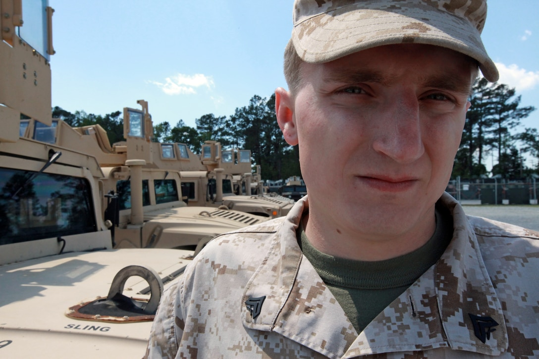 Corporal Tim D. Ross, a motor transportation operator with Training and Operations office, 2nd Marine Division, prepares humvees for future licensing operations, April 11. Ross, a Forest Grove, Ore., native, has deployed to Afghanistan and currently trains Marines how to operate various vehicles including the humvee. Ross said a major contributing factor in his enlistment to the Corps was the attacks of Sept. 11, 2001.