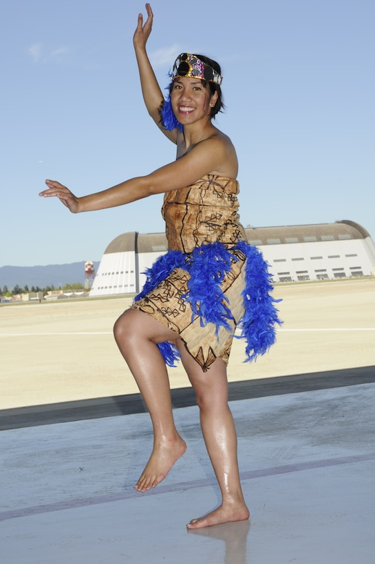 Senior Airman Sarah Fepuleai, a supply management journeyman with the 129th Logistics Readiness Squadron and America-Samoa native, performed a traditional taulaga dance at the Asian Pacific American Heritage lunch May 2, 2010 at Moffett Federal Airfield. Asian Pacific American Heritage Month is celebrated in May to commemorate the contributions of people of Asian and Pacific Islander descent in the United States. (Air National Guard photo by Staff Sgt. Kim Ramirez)