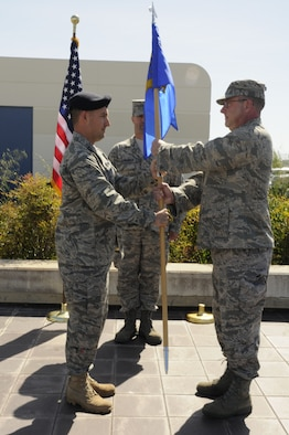 Col. Charles Ingalls, the 129th Mission Support Group commander presents the 129th Security Forces guidon to Capt. Thomas Maranda, the former 129th SFS operations officer in an assumption of command ceremony May 1, 2010 at Moffett Federal Airfield, Calif. Captain Maranda is assuming command of the 129th SFS. Colonel Ingalls temporarily held command of Security Forces while Captain Maranda was at technical training to become the 129th SFS commander. (Air National Guard photo by Staff Sgt. Kim Ramirez)