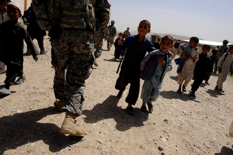 Afghan children pass Provincial Reconstruction Team Zabul Airmen and Soldiers during a foot patrol, May 23, 2010, in Qalat City, Afghanistan. (U.S. Air Force photo/Staff Sgt. Manuel J. Martinez)