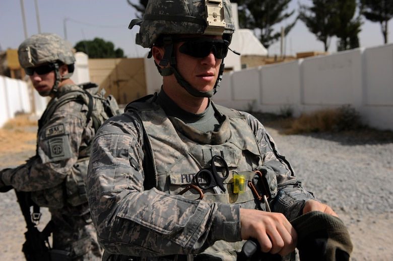 First Lieutenant Shane Futchko, a physician assistant assigned to Provincial Reconstruction Team Zabul, gears up for a foot patrol May 23, 2010, at Forward Operating Base Smart, Afghanistan. (U.S. Air Force photo/Staff Sgt. Manuel J. Martinez/released)