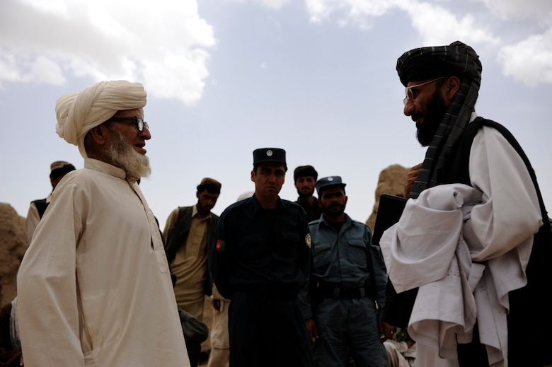 A village elder, left, representing the population of a village speaks with Omar Gul, the Zabul Provincial Line Director of Irrigation, during a Shura meeting May 22, 2010, in Omarkhel, Afghanistan. (U.S. Air Force photo/Staff Sgt. Manuel J. Martinez/released)