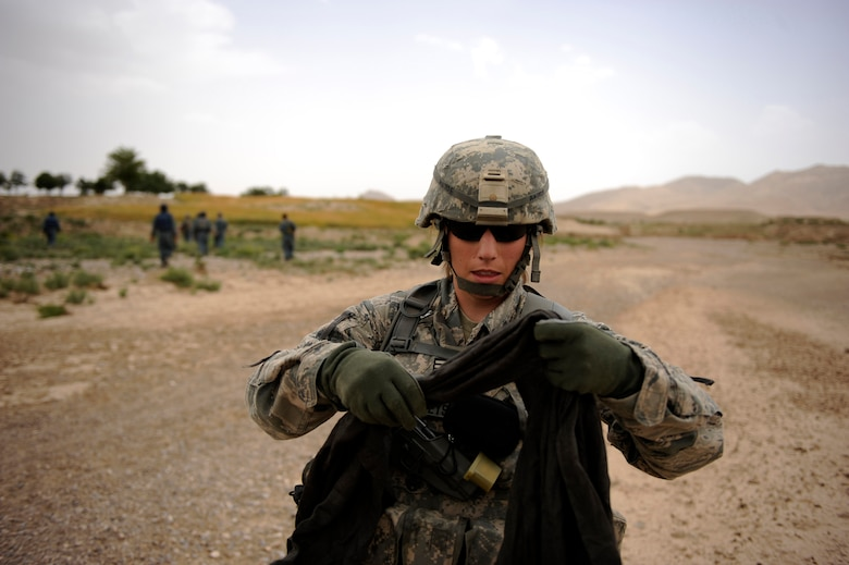 First Lieutenant Rebecca Heyse, an information officer assigned to Provincial Reconstruction Team Zabul, puts on her burka prior to entering Omarkhel village for a Shura May 22, 2010, in Zabul Province, Afghanistan. (U.S. Air Force photo/Staff Sgt. Manuel J. Martinez/released)
