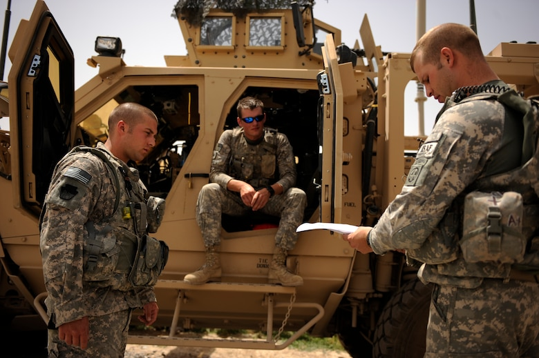 Army Sergeant Robert Crosier, right, a truck commander assigned to Provincial Reconstruction Team Zabul, briefs his gunner and driver before heading out on a Shura mission in a local village May 22, 2010. (U.S. Air Force photo/Staff Sgt. Manuel J. Martinez/released)