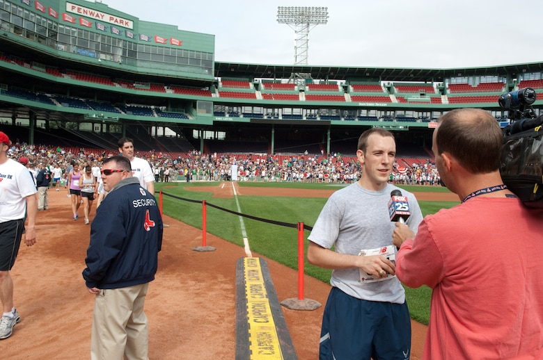 BOSTON – 1st Lt. Ronald Jenkins, 350th Electronic Systems Group, is interviewed after finishing 14th of more than 2,000 participants in the Run to Home Base 9K race at Fenway Park. The race benefitted the Home Base Program, which offers treatment and support to veterans of Operations Iraqi and Enduring Freedom who suffer from traumatic brain injuries and deployment-related stress disorders.  (U.S. Air Force photo by Rick Berry)