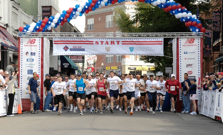 BOSTON – Participants in the Run to Home Base 9K race pour across the Yawkey Way starting line on May 23. More than 2000 runners each donated $1,000 to compete in the race and cross the finish line at Fenway Park's home plate. The donations will benefit the Home Base Program, which offers treatment, research and counseling to Iraq and Afghanistan veterans suffering from traumatic brain injuries and deployment-related stress disorders. Army Chief of Staff Gen. George W. Casey and Massachusetts Lt. Gov. Tim Murray were in attendance.  (U.S. Air Force photo by Rick Berry)