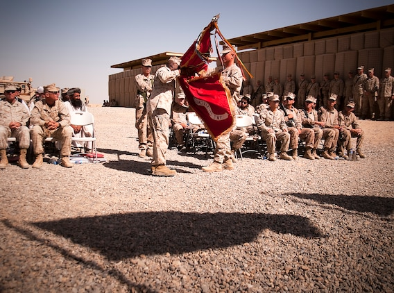 Lt. Col. Matt Baker and Sgt. Maj. Dwight D. Jones, commanding officer and sergeant major, 1st Battalion, 3rd Marine Regiment, retire the battalion colors during a transfer of authority ceremony at Forward Operating Base Geronimo where 1/3 handed over their area of operations to 3rd Battalion, 3rd Marine Regiment, June 6.