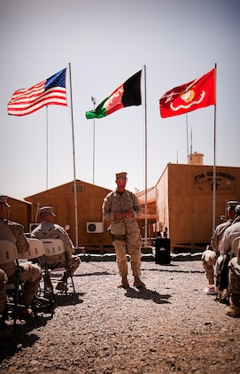 """Col. Randall P. Newman, commanding officer, Regimental Combat Team 7, addresses the crowd at a transfer of authority ceremony at Forward Operating Base Geronimo where 3rd Battalion, 3rd Marine Regiment, took over 1st Battalion, 3rd Marine Regiment's area of operations, June 6. """"To Lt. Col. [Matt] Baker and the team of 1/3, it's been a true honor to watch you work,"""" Newman said. """"It's not without a great amount of effort, sacrifice, and blood, sweat and tears that progress is made in a fight like this. I appreciate every bit of what you guys have put forward."""""""