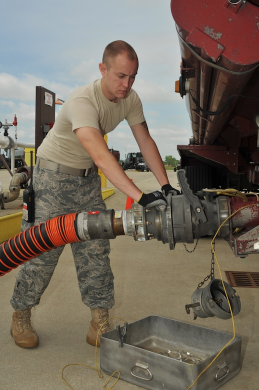 """Senior Airman Andrew Kasten, a fuels laboratory technician for the 126th Fuels Management flight, transfers fuel to holding tanks located at the 126th Air Refueling Wing, Scott AFB, Ill. The Illinois Air National Guard flight was recently named """"The Best in the Air National Guard"""" and received the Air National Guard Outstanding Fuels Management Flight Award for the best fuels operations for 2009. (U.S. Air Force photo by Master Sgt. Ken Stephens)"""