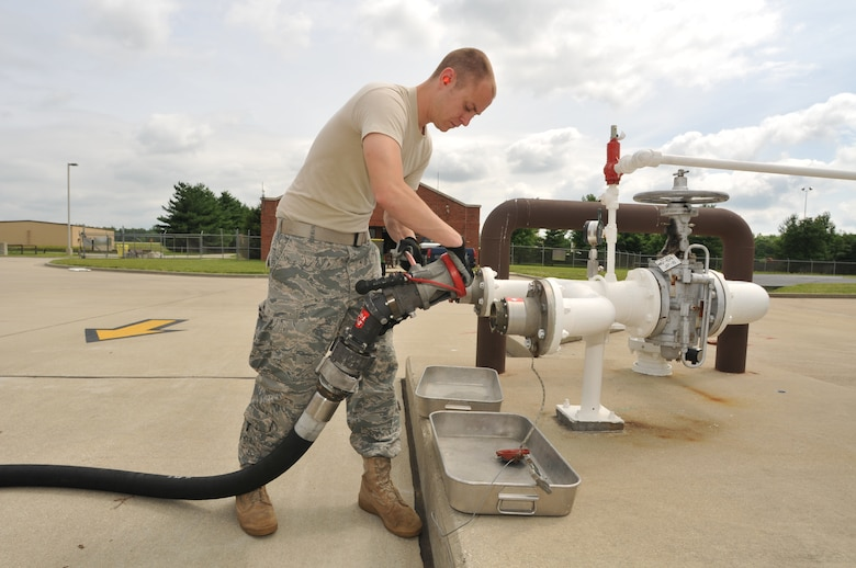 """Senior Airman Andrew Kasten, a fuels laboratory technician for the 126th Fuels Management flight, transfers fuel from holding tanks to a fuel truck located at the 126th Air Refueling Wing, Scott AFB, Ill. The Illinois Air National Guard flight was recently named """"The Best in the Air National Guard"""" and received the Air National Guard Outstanding Fuels Management Flight Award for the best fuels operations for 2009. (U.S. Air Force photo by Master Sgt. Ken Stephens)"""