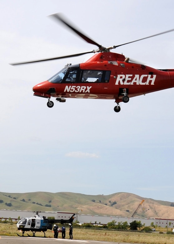 A civilian air ambulance transports a simulated injured patient at an emergency response exercise at Travis Air Force Base, California on 12 May 2010.  Military personal and local civilian emergency organizations worked together during the exercise.  (U.S. Air Force photo by Civ/Jay Trottier)
