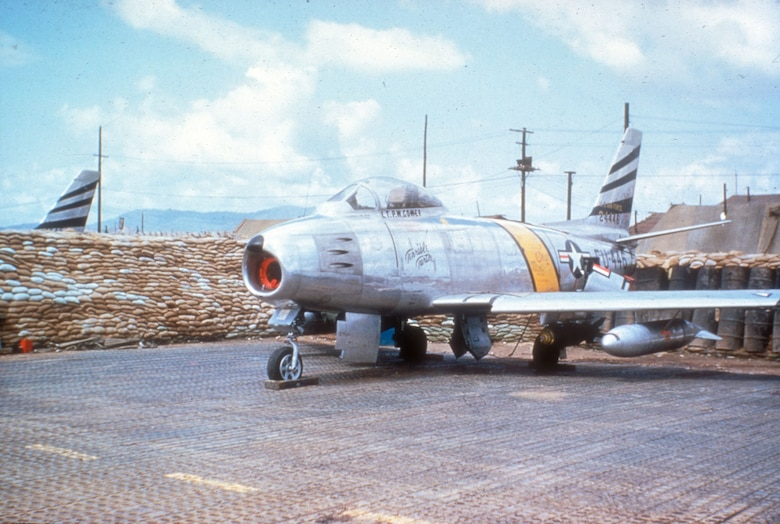 F-86F sitting on PSP (Pierced Steel Planking). PSP was used to create temporary runways. (U.S. Air Force photo)
