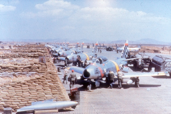 Rows of F-86Es being readied for a mission. (U.S. Air Force photo)