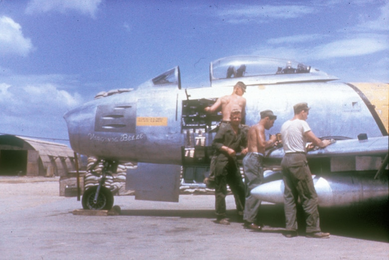Armorers tend to the guns of an F-86. (U.S. Air Force photo)