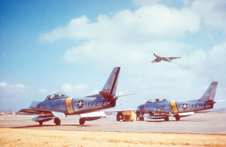 F-86Es in April 1952. In late 1951 F-86 units applied yellow bands on the fuselage and wings as a recognition aid. Previously, these markings were black and white stripes. (U.S. Air Force photo)