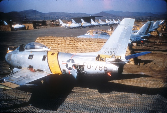 F-86s parked in sandbag revetments on an air base in Korea. The sandbags protected aircraft from bomb fragments. (U.S. Air Force photo)
