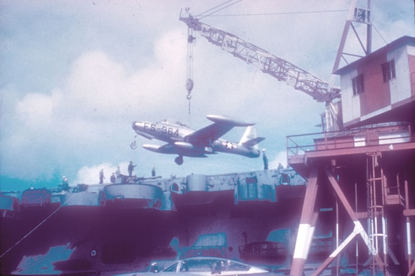 In November 1950 the Air Force sent the highly-experienced 27th Fighter Escort Group to Korea to protect B-29 bombers from MiG-15 attacks. Pictured here are 27th FEG F-84s being loaded onto the carrier USS Bataan for shipment to Korea. (U.S. Air Force photo)