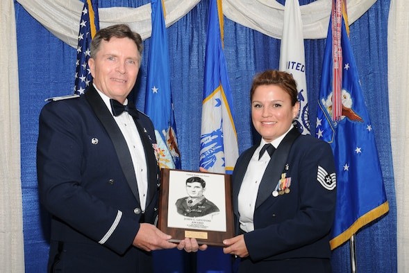 McGHEE TYSON AIR NATIONAL GUARD BASE, Tenn. --  Air Force Tech. Sgt. Melanie D. Dufresne, right, the NCOIC of the ambulatory procedures unit, 88th Surgical Operations Squadron, Wright-Patterson AFB, Ohio, receives the John L. Levitow honor award for NCO Academy Class 10-5 at The I.G Brown Air National Guard Training and Education Center here from Col. Richard B. Howard, commander, June 2, 2010.  The John L. Levitow award is the highest honor awarded a graduate of any Air Force enlisted professional military education course.  (U.S. Air Force photo by Master Sgt. Kurt Skoglund/Released)