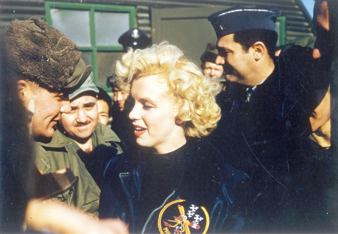 USO personnel and celebrities visited service members in Korea. Baseball player Joe DiMaggio and actress Marilyn Monroe famously toured Korea shortly after the Armistice. Here, Monroe is among Air Force personnel and wearing a 6147th Tactical Control Group jacket. (U.S. Air Force photo)