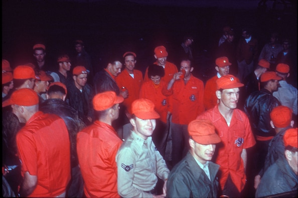 Airmen often showed pride by displaying their unit's color in different ways. In this photo, 13th Bomb Squadron Airmen are wearing red shirts and hats during a party. (U.S. Air Force photo)