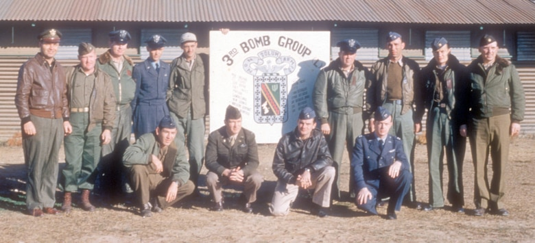 The varied uniforms in this photograph illustrate the USAF in transition during the Korean War. Some wear the old uniform of the U.S. Army Air Forces (USAAF) while others wear newly issued USAF blues or a combination of both. (U.S. Air Force photo)