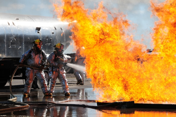 U.S. Air National Guard Fire Fighter Aaron Nelson and Tech. Sgt Nick Downs, 148th Fighter Wing, fight a fire during a Major Accident Response Exercise (MARE) of a commercial airliner crash at the  Duluth International Airport, Minn., June 3, 2010. The MARE was held in conjunction with local, state and federal emergency response agencies to test and validate emergency response capabilities. (U.S. Air Force photo by Master Sgt. Jason W. Rolfe/Released)