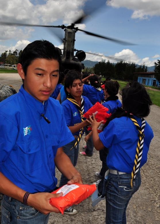 Scouts Guatemala and members of the community of Santa Cruz del Quiche, Guatemala begin offloading food and water from a Joint Task Force-Bravo CH-47 Chinook June 5. Joint Task Force-Bravo's helicopters have transported approximately 94,000 pounds of relief supplies since June 2 to Guatemalan communities in need. (U.S. Air Force photo by Staff Sgt. Bryan Franks)