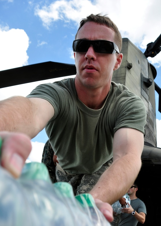 Captain Grant Hill, 1st Battalion, 228th Aviation Regiment from Soto Cano Air Base, Honduras, loads water onto a CH-47 Chinook June 5 at the Guatemala City Airport. The 1/228th, along with other members of Joint Task Force-Bravo, deployed June 1 at the request of the Guatemalan government to support disaster relief efforts following the Pacaya Volcano eruption and Tropical Storm Agatha. (U.S. Air Force photo by Staff Sgt. Bryan Franks)