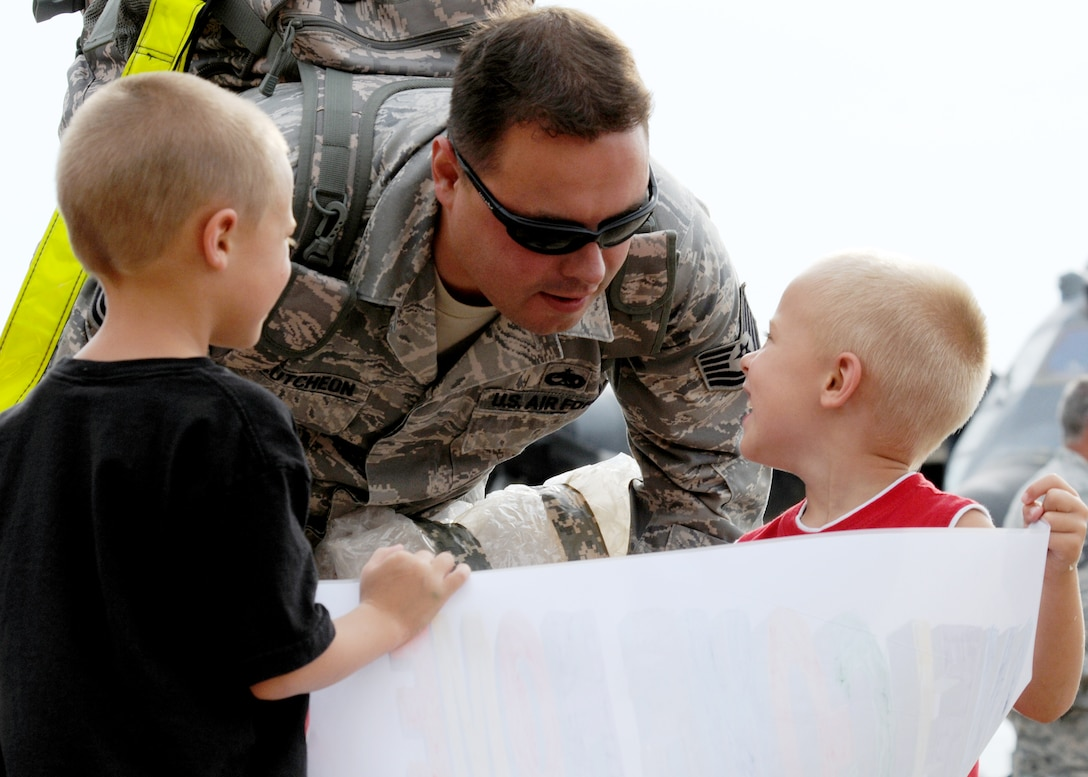 "Tech Sgt. Aaron McCutcheon, 919th Maintenance Group, checks out the ""welcome home"" sign his two sons made for him upon returning from an Operation Iraqi Freedom June 6 at Eglin Air Force Base, Fla. More than 70 Airmen from Duke Field returned home from their deployment June 5 and 6. Friends, family, co-workers and community leaders came out to greet them and welcome the Airmen home. (U.S. Air Force photo/Tech. Sgt. Samuel King Jr.)"