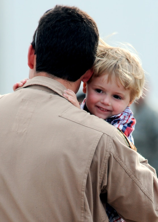 A father from the 919th Special Operations Wing, carries around his son upon returning from an Operation Iraqi Freedom deployment June 6 at Eglin Air Force Base, Fla. More than 70 Airmen from Duke Field returned home from their deployment June 5 and 6. Friends, family, co-workers and community leaders came out to greet them and welcome the Airmen home. (U.S. Air Force photo/Tech. Sgt. Samuel King Jr.)