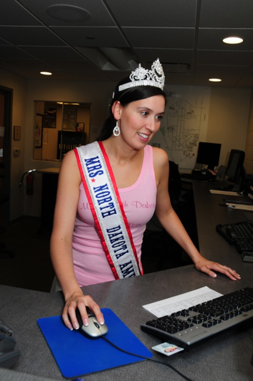 Newly crowned Mrs. North Dakota America, Tech. Sgt. Tera Miller, of the 119th Operations Support Squadron, visits her work area June 7, at the North Dakota Air National Guard, Fargo, N.D.  Miller was selected 2010 Mrs. North Dakota America at the Grand Masonic Lodge, June 6, in Fargo.  One of Millers competitors for the crown was fellow Guard member SGT. Jill Johnson, with the North Dakota Army National Guard.  Miller will advance to the National Mrs. America pageant in Tuscan, Ariz., in September.  Miller, along with her twin sister Tech. Sgt. Lisa Narum joined the North Dakota Air National Guard in 2001. (DoD photo by Senior Master Sgt. David H. Lipp)