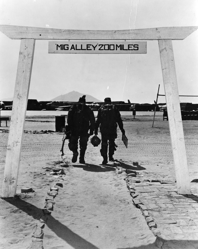 Famous photo of the torii gate leading to the Sabre flight line at Kimpo Air Base. Although torii gates had their origins as entrances to Japanese Shinto shrines, this image has become an enduring symbol of the Air Force during the Korean War. (U.S. Air Force photo)