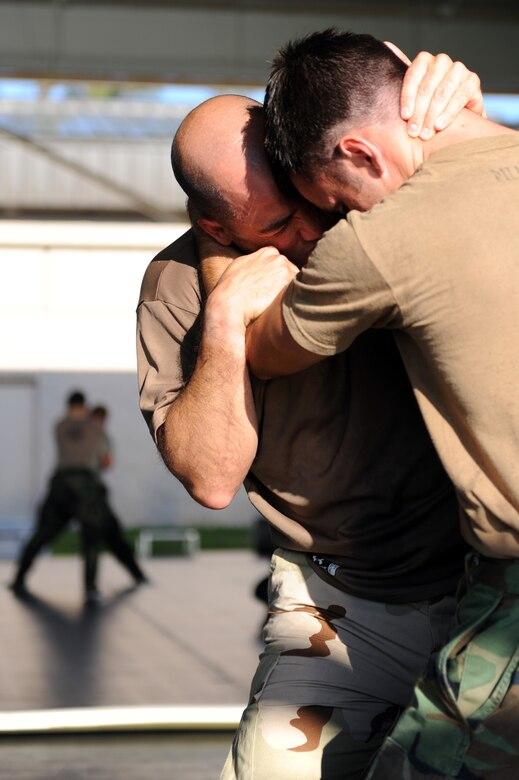 Master Sgt. John Sosa fights Senior Airman Patrick Murphy during a combative class taught by Ultimate Fighting Championship Middleweight Alan Belcher June 8, 2010, at Hurlburt Field, Fla. (U.S. Air Force photo/Staff Sgt. Desiree N. Palacios)