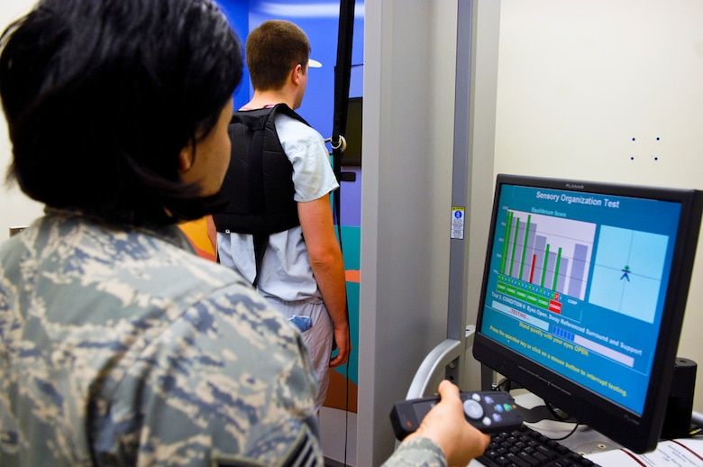 ELMENDORF AIR FORCE BASE, Alaska –Staff Sgt. Kim Munoz, 3rd Medical Group Otolaryngology technician and Airman 1st Class Matthew Kenneson, 3rd Medical Group surgical service technician, test a Balance Manager, a machine that is used to give Postureography tests, which test assess a patient's equilibrium and ability to balance. (Air Force photo by Airman 1st Class Jack Sanders)