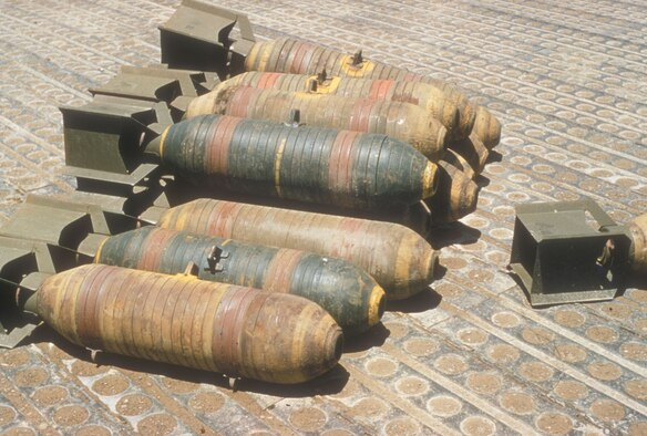 USAF interdiction aircraft carried a number of different weapons, including the fragmentation bombs pictured here. The bomb casings were partially cut so they detonated into more pieces. (U.S. Air Force photo)