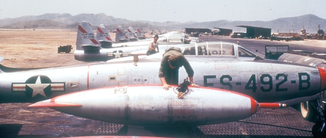 The refueling probe of the type used during OPERATION HIGH TIDE is visible on the front of the wing tip fuel tank of this F-84E. (U.S. Air Force photo)