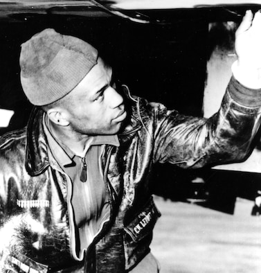 B-26 gunner C.W. Ledbetter inspects his aircraft. The number of missions he has flown is proudly displayed as bombs on his A-2 jacket. (U.S. Air Force photo)