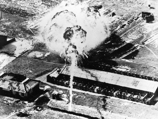 Napalm fireball about to engulf a communist supply building in March 1951. (U.S. Air Force photo)