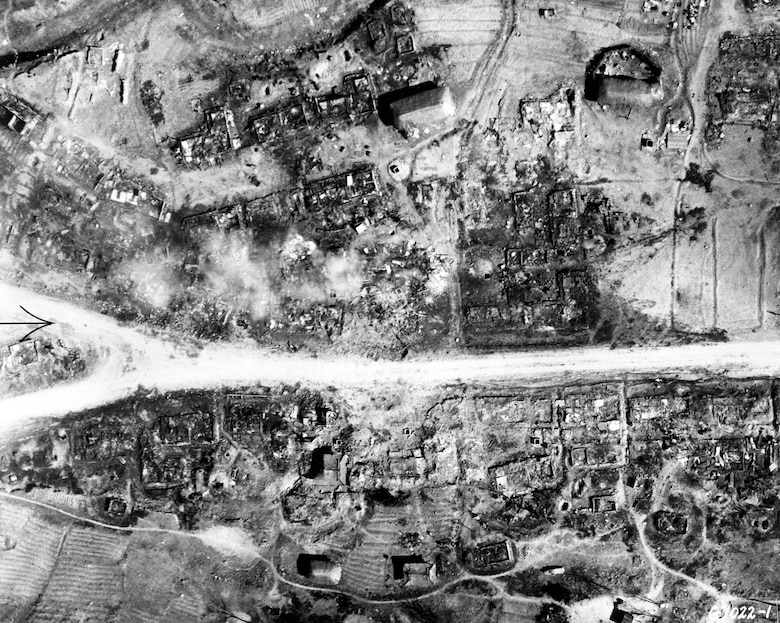 Air Force light bombers laid waste to this cluster of storage warehouses west of Pyonggang, North Korea. (U.S. Air Force photo)