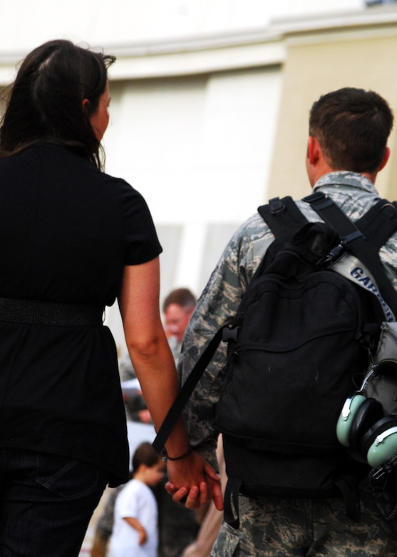 A 919th Special Operations Wing war returnee and his wife head for home moments after his arrival at Eglin Air Force Base, Fla., June 6. More than 70 Airmen from Duke Field returned home from their deployment June 5 and 6. Friends, family, co-workers and community leaders came out to greet them and welcome the Airmen home. (U.S. Air Force photo/TSgt. Cheryl Foster)