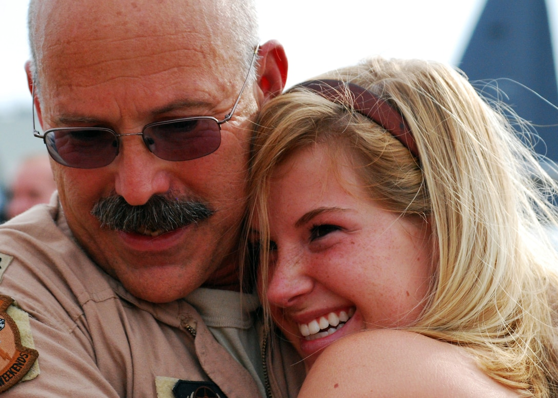 Lieutenant Col. Bud Barth hugs his daughter, Jessie, moments after landing at Eglin Air Force Base, Fla., June 6. More than 70 Airmen from Duke Field returned home from their deployment June 5 and 6. Friends, family, co-workers and community leaders came out to greet them and welcome the Airmen home. (U.S. Air Force photo/TSgt. Cheryl Foster)