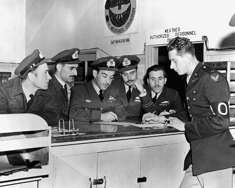 Greek airmen of the Royal Hellenic Air Force being briefed by a USAF officer (right) on a C-47 flight to carry supplies to UN forces near the front. (U.S. Air Force photo)