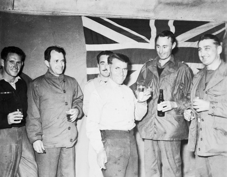 """Col. Francis """"Gabby"""" Gabreski (far right) with members of the Royal Australian Air Force No 77 Squadron. Gabreski was the commander of the F-86-equipped 51st Fighter-Interceptor Wing, and an ace in World War II and in Korea. (U.S. Air Force photo)"""