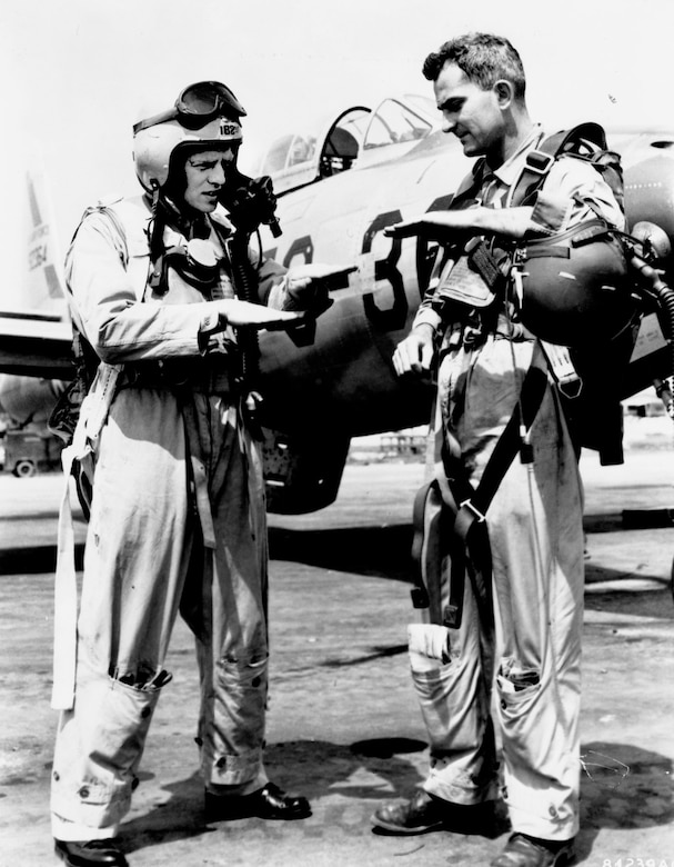 Texas Air National Guard pilots 1st Lt. Arthur Oligher (left) and Capt. Harry Underwood of the 182nd Fighter-Bomber Squadron, 136th Fighter-Bomber Wing, discuss downing a MiG-15 jet. Flying F-84s, their combined kill on June 26, 1951, was the first jet combat victory for Air Guard pilots. (U.S. Air Force photo)
