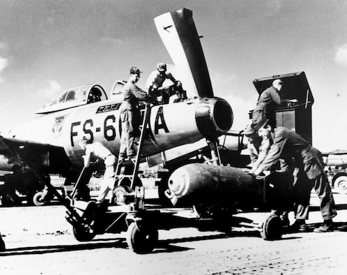 Ground crewmen from the Florida Air National Guard's 159th Fighter Squadron ready an F-84 for combat in Korea. (U.S. Air Force photo)