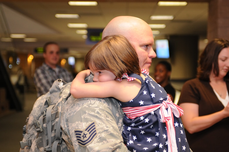 Tech. Sgt.  Michael Royval is welcomed home after a five-month deployment to Iraq, June 6. Family and friends celebrated the return of 29 security forces Airmen assigned to the 162nd Fighter Wing at Tucson International Airport. (Air Force photo by Maj. Gabe Johnson)