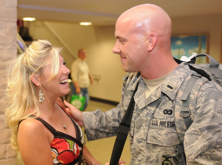 1st Lt. Ben Swope is welcomed home after a five-month deployment to Iraq, June 7. Family and friends celebrated the return of 29 security forces Airmen assigned to the 162nd Fighter Wing at Tucson International Airport. (Air Force photo by Maj. Gabe Johnson)