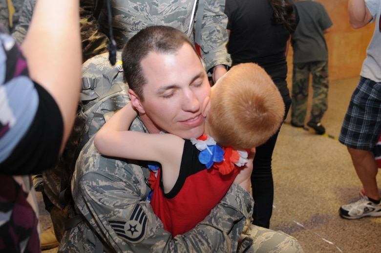Staff Sgt. Jonathan Morphew is welcomed home after a five-month deployment to Iraq, June 7. Family and friends celebrated the return of 29 security forces Airmen assigned to the 162nd Fighter Wing at Tucson International Airport. (Air Force photo by Maj. Gabe Johnson)